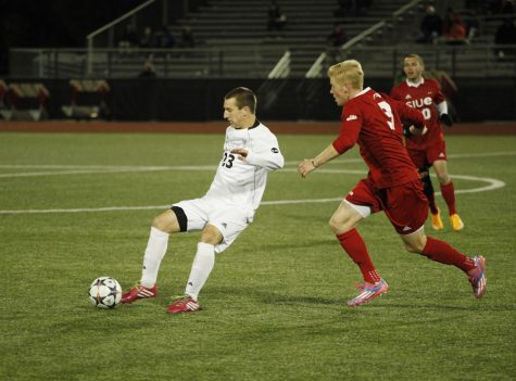 Sophomore defender Cody Witkowski (left) passes the ball Wednesday night at the Soccer and Track & Field Complexin the game against Southern Illinois-Edwardsville. Witkowski scored one of four NIU goals in the victory.