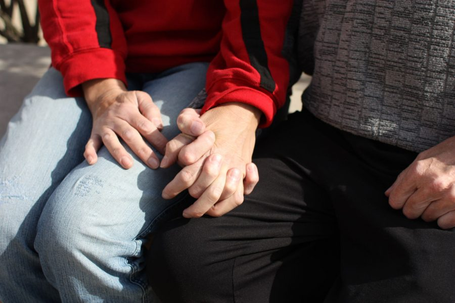 Tina Erickson (left) and her husband Brad Erickson hold hands. Before Tina Erickson collapsed and stopped breathing at the university's Campus Mail Services Sept. 12, she had no prior health issues, Brad Erickson said. Now she is undergoing tests to reach a diagnosis for what caused her collapse.