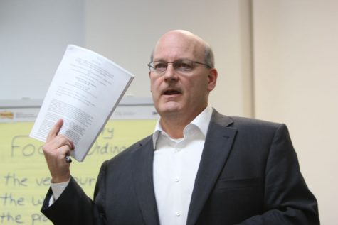 Focus DeKalb attorney Mike Coghlan speaks about how he thinks a portion of the original material within the Commercial/Industrial Building Responsibility Code Ordinance is unconstitutional and discusses proposed amendments during a meeting Wednesday at 1719 Sycamore Road.
