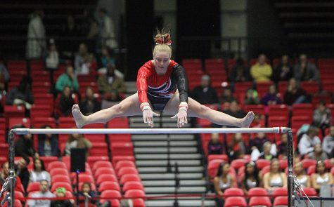 Senior Meg Piepenbrink performs on the bars in the Huskies' home opener Friday at the Convocation Center in the meet vs. the Kent State Golden Flashes. At 47.825, bars was the lowest score for the Huskies, who out-scored Kent State on vault and floor en route to a historic home victory.