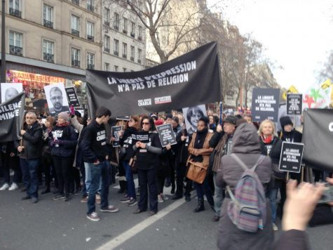 People march in the streets of Paris to show support for freedom of expression in the wake of the Jan. 7 Charlie Hebdo slayings. History professor Brian Sandberg, who was in Paris during the massacre, said he plans to use his experiences when teaching his comparative religious violence class.
