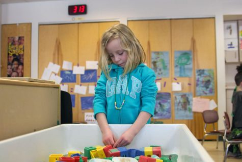 """Sadie Lang, 4, of Sycamore, plays at the sand table Friday at Campus Child Care. The center """"predominately"""" serves student families, said Christine Kipp, director of NIU Campus Child Care."""