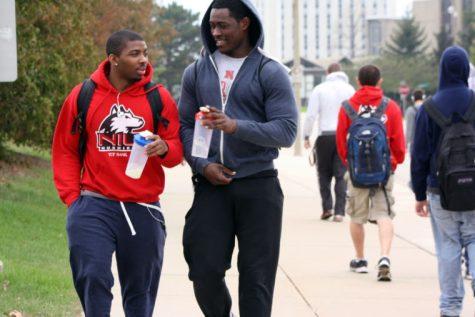 Freshman psychology major Jason Betts Jr. (left) and sophomore English major Jalen Olajuwon walk down Lucinda Avenue on April 28, 2014, following a workout at the Recreation Center.
