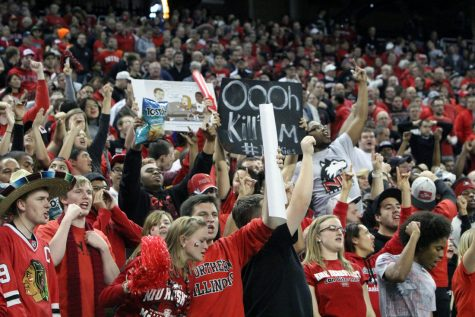 Students cheering on the NIU Huskies at the MAC championship football game last year.