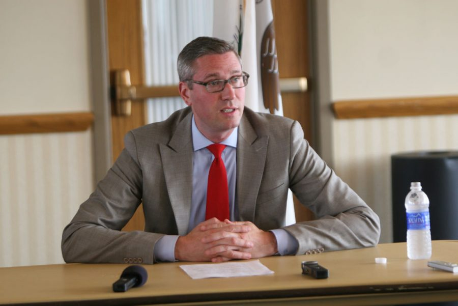 Illinois Treasurer Mike Frerichs talks to a group of 16 NIU and DeKalb leaders Monday during a round table discussion in the Holmes Student Center Sky Room. Students are seven times more likely to go to college if they know they have the financial means to do so, said Frerichs, who visited NIU to express his support for MAP funding, among other things.