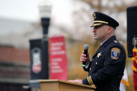 """NIU Police Chief Thomas Phillips speaks about issues facing veterans Nov. 11 during a Veterans' Day ceremony at the flagpole southeast of Altgeld Hall. """"Whether it's donation or volunteerism, we can all make a difference,"""" Phillips said. """"Regardless of how you choose to help, the important message is try to give back something to the men and women who have given so much to defend our way of life."""""""