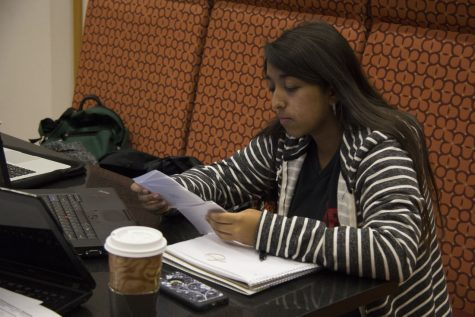 Nadia Ramos, freshman medical laboratory science major, studies using flashcards Oct. 14 in the Founders Memorial Library Cafe.