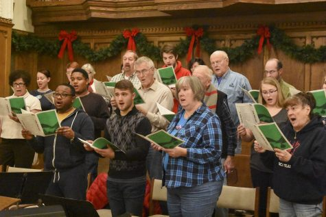 Members of the First United Methodist Church choir practice music in the main sanctuary of the church Wednesday evening.
