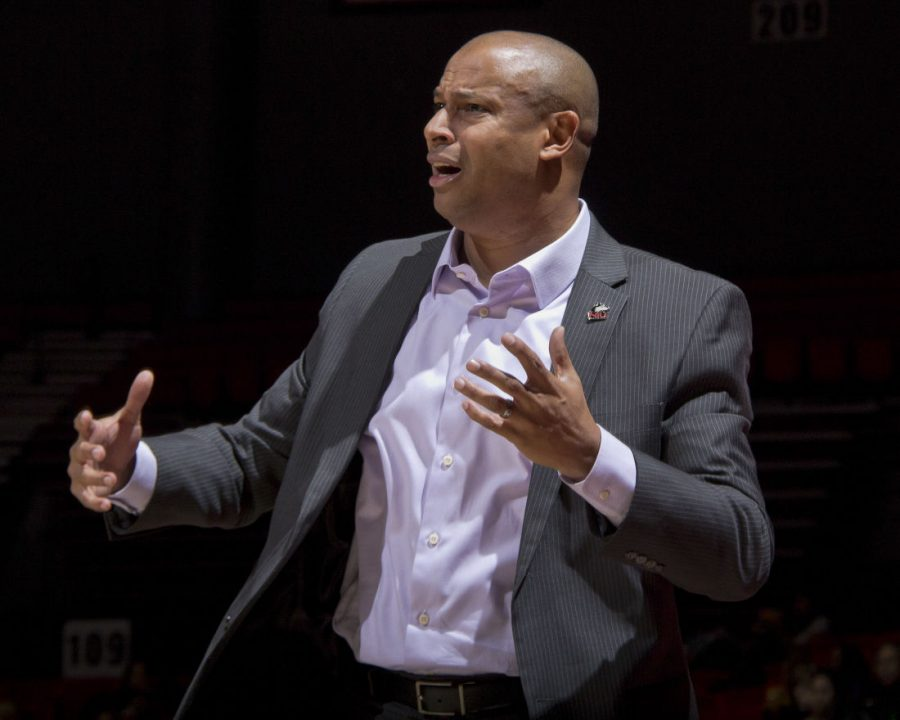 Head coach Mark Montgomery contests a call in a Dec. 2 game against Chicago State. Montgomery has coached the Huskies to their best start since his 2011 arrival, and the team is one win away from beating last season's total wins.