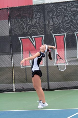 Evelyn Youel serves against Western Michigan on April 12. The Huskies would fall to the Broncos 4-3.