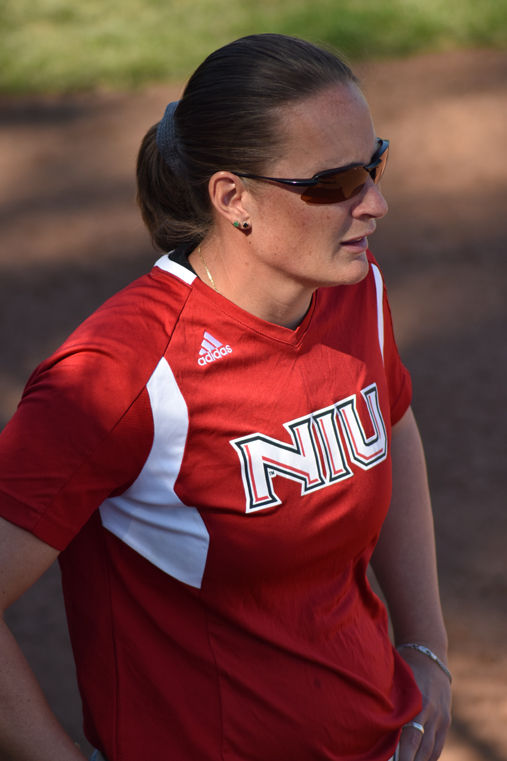 Head Coach Christina Sutcliffe coaches from third base during the Huskie's game against the Western Michigan Broncos on April 15.