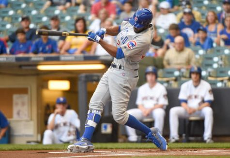 Chicago Cubs' Dexter Fowler swings on a lead-off home run off Milwaukee Brewers starting pitcher Jimmy Nelson during the first inning of a baseball game Friday, July 22, 2016, in Milwaukee.