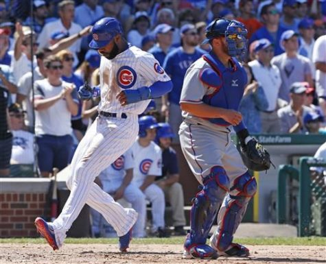 Chicago Cubs outfielder Jason Heyward (left) scores a run in Saturday's game against the Texas Rangers. Heyward went 0-3 with a walk and a strikeout in the game as the Cubs fought Texas off for a 3-1 win, their third straight victory following a four-game skid.