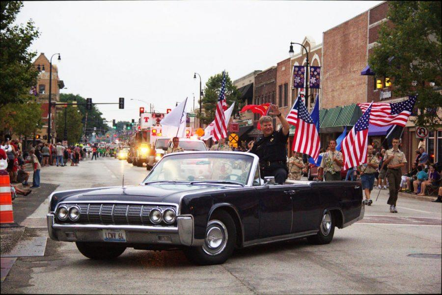 On Lincoln Highway, the DeKalb police force leads the seventh annual Kishwaukee Festival parade in downtown DeKalb on Friday.