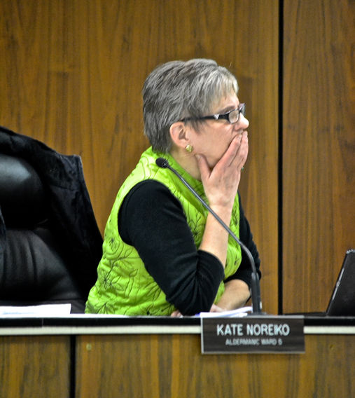 Fifth Ward Alderwoman Kate Noreiko listens to a speaker during a former city council meeting which occur the second and fourth Monday of each month.