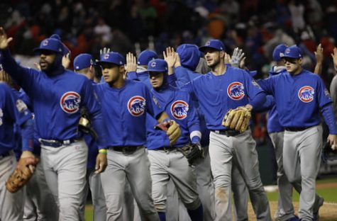 The Chicago Cubs celebrate after Game 2 of the Major League Baseball World Series against the Cleveland Indians Wednesday in Cleveland. The Cubs won 5-1 to tie the series 1-1.