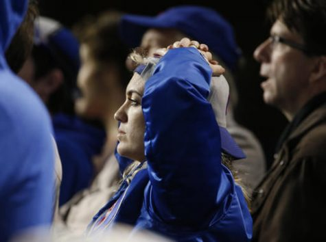 Chicago Cubs fans watch during the eighth inning of Game 4 of the Major League Baseball World Series between the Chicago Cubs and the Cleveland Indians today in Chicago.