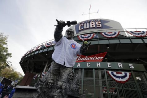 The statue of famed Cubs broadcaster Harry Carey is seen Friday outside Wrigley Field before game three of the Major League Baseball World Series between the Chicago Cubs and the Cleveland Indians.