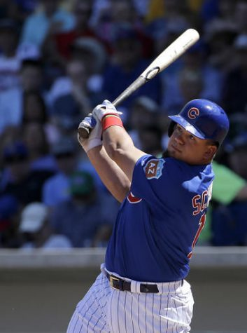 Chicago Cubs' Kyle Schwarber bats against the Milwaukee Brewers during a spring training baseball game March 25 in Mesa, Arizona. Schwarber has been added to the Chicago Cubs' World Series roster and could start Tuesday night's opener against the Cleveland Indians at designated hitter.