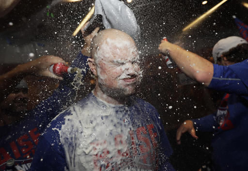 Chicago Cubs' Jon Lester is doused as players celebrate after Game 6 of the National League baseball championship series against the Los Angeles Dodgers, today in Chicago. The Cubs won 5-0 to win the series and advance to the World Series against the Cleveland Indians.