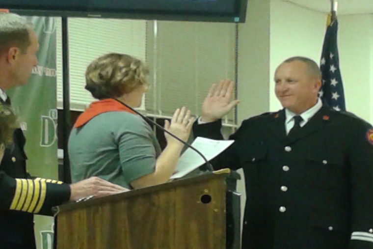 DeKalb+Fire+Captain+Todd+Stoffa+is+sworn+into+duty+during+a+city+council+meeting+6+p.m.+Monday.+Stoffa+has+been+a+firefighter+for+18+years.