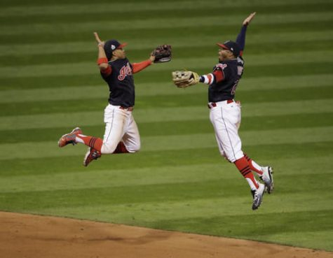 Cleveland Indians' Francisco Lindor and Rajai Davis celebrate after Game 1 of the Major League Baseball World Series against the Chicago Cubs Tuesday in Cleveland. The Indians won 6-0 to take a 1-0 lead in the series.