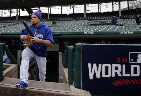Kyle Schwarber, Chicago Cubs designated hitter, walks out to the field to work out for Friday's Game 3 of the Major League Baseball World Series against the Cleveland Indians, Thursday, in Chicago.