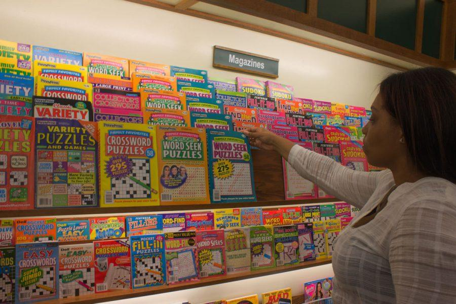 Junior nursing major Jasmine Dobbs looks at the puzzle books at Book World, 858 W. Lincoln Highway.