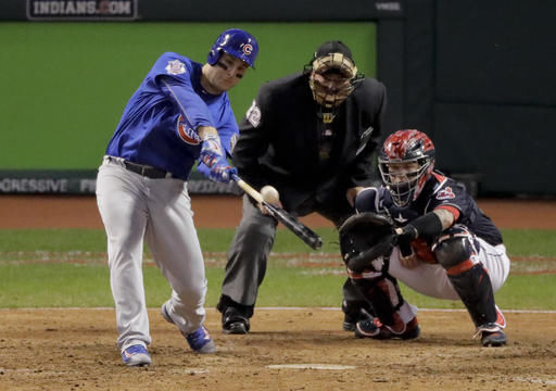 Chicago Cubs' Anthony Rizzo hita two run home rum against the Cleveland Indians during the ninth inning of Game 6 of the Major League Baseball World Series Tuesday Nov. 1 in Cleveland.