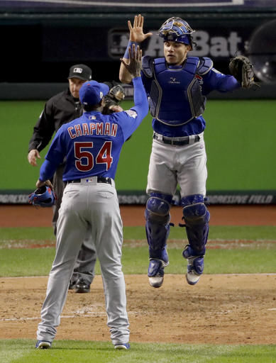 Chicago Cubs relief pitcher Aroldis Chapman (left) and catcher Willson Contreras celebrates their win against the Cleveland Indians after Game 2 of the World Series Wednesday in Cleveland. The Cubs won 5-1 to tie the series 1-1.