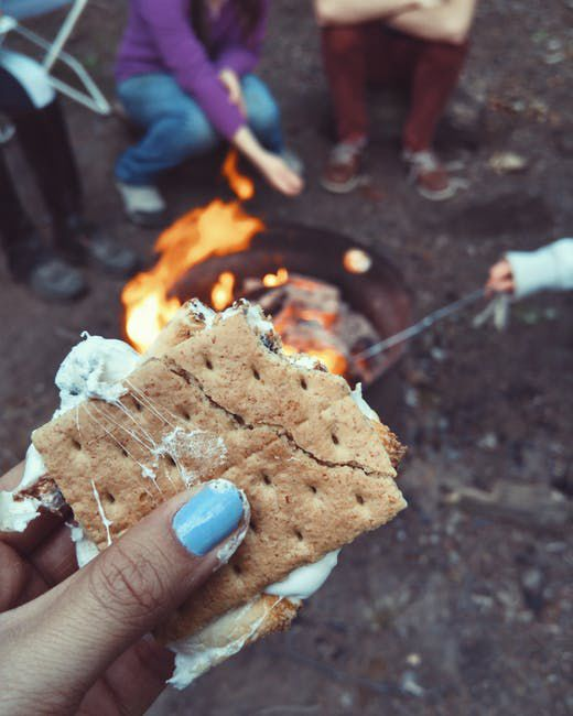 S'mores being enjoyed at a bonfire.