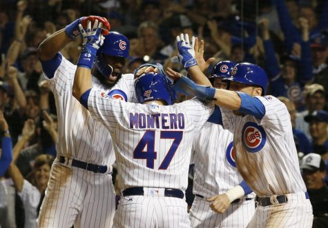 Chicago Cubs' Miguel Montero (47) celebrates a grand slam during the eighth inning of Game 1 of the National League baseball championship series against the Los Angeles Dodgers Saturday, Oct. 15, 2016, in Chicago. (AP Photo/Nam Y. Huh)