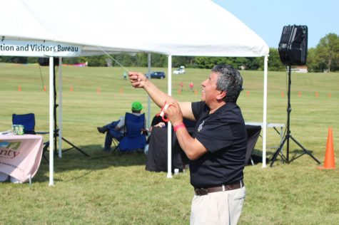 DeKalb resident, Jose Rosas, participates in the fun by testing out a kite in the sky at Kite Fest on Sunday.