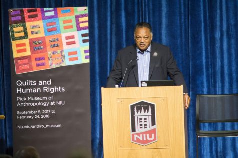 "The Rev. Jesse Jackson was welcomed by students, administrators and faculty of NIU inside the Sandburg Auditorium on Tuesday. Jackson brought emphasis in saying, ""This land is our land, it was made for all of us"". This message carried through the entire day as the exhibit touched on many social injustices, current events and politics."