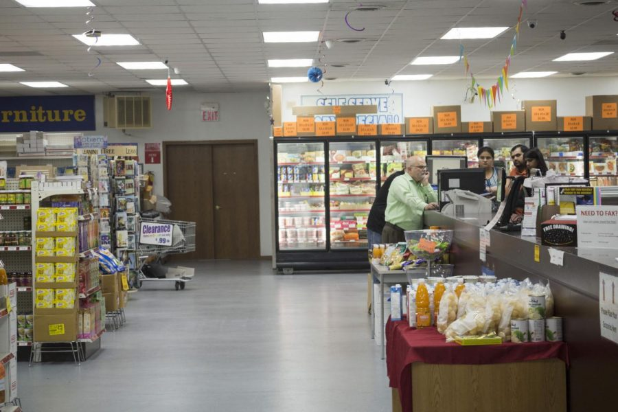 Employees at the Gurukrupa Indian Grocery & Copy Service, 1005 W. Lincoln Highway, engage with customers Wednesday. The grocer is one of multiple cultural food options in DeKalb that city officials say benefits the local economy and caters to the city's diverse population.