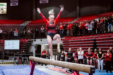 Senior Katherine Prentice balances on the beam in the Huskies' home loss Sunday to Central Michigan. Prentice finished with a score of 9.675 on the balance beam.