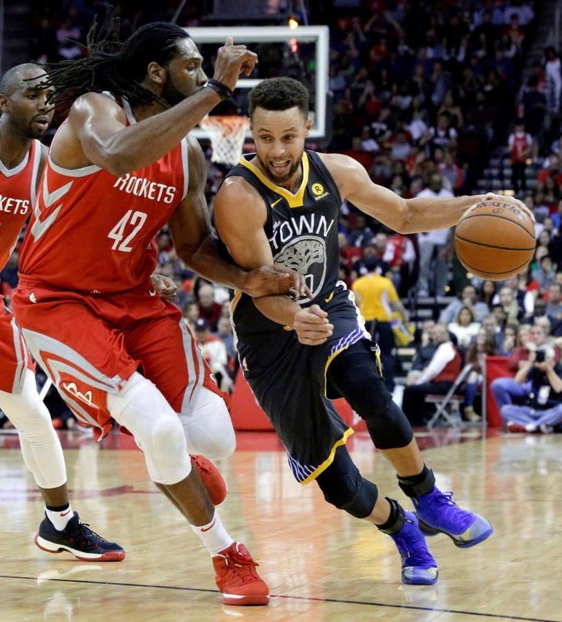 Golden State Warriors guard Stephen Curry drives to the lane against Houston Rockets center Nene in their game Saturday in the Rockets' 116-108 home win.Curry received the most votes for the Western Conference.