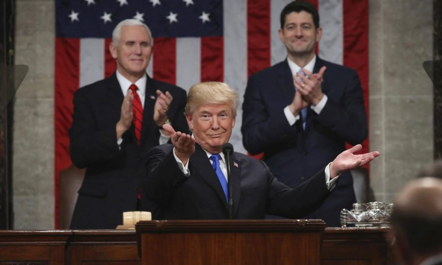 President+Donald+Trump+gestures+as+he+delivers+his+first+State+of+the+Union+address+in+the+House+chamber+of+the+U.S.+Capitol+to+a+joint+session+of+Congress+Tuesday%2C+Jan.+30%2C+2018%2C+in+Washington%2C+as+Vice+President+Mike+Pence+and+House+Speaker+Paul+Ryan+applaud.+%28Win+McNamee%2FPool+via+AP%29