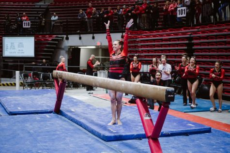 Senior gymnast Ashley Potts finishes her balance beam exercise in the Huskies' home loss Jan. 28 to Central Michigan.