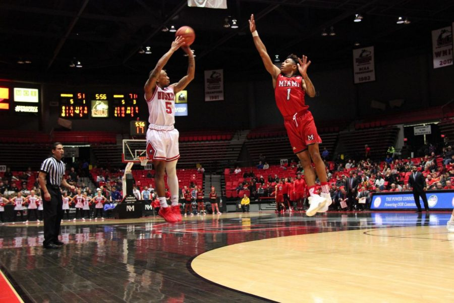 Sophomore guard Justin Thomas shoots a 3-pointer in the Huskies' 81-65 home loss Saturday to Miami University. Thomas finished with 14 points.