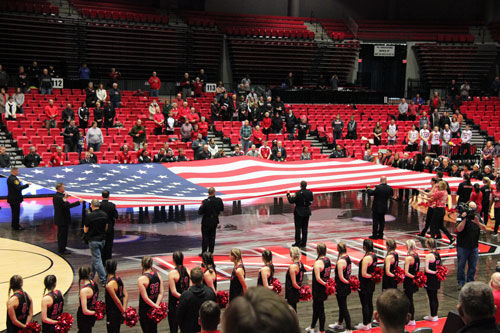 First responders to the Feb. 14, 2008 shooting hold the American flag at a recognition service during halftime of a men's basketball game against Bowling Green Saturday.
