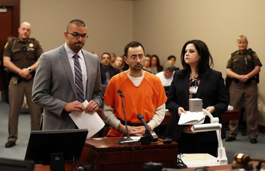 Lawrence Nassar (center) was sentenced to up to 175 years in prison after being found guilty of sexual assault.