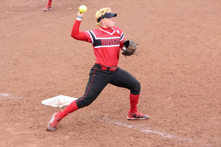 Senior infielder Alaynie Woollard throws to first base in the Huskies' 9-1 win March 30 against the University at Buffalo Bulls.
