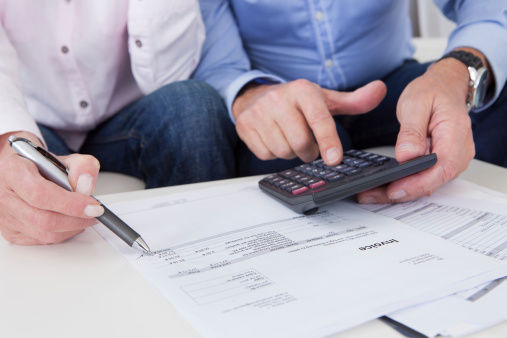 Close-up of couple doing finances at home