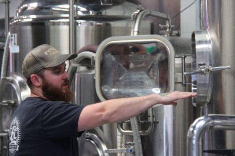 Head brewer John Sanderson shows some of the various instruments used to create microbrew craft beers.