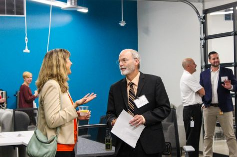 Gerald Blazey, vice president for research and innovation partnership, speaks with Discover Director Jennifer Joseph during the code_orange program grand opening.