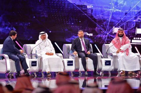 In this photo released by Saudi Press Agency, SPA, Saudi Crown Prince, Mohammed bin Salman, right, Lebanese Prime Minister, Saad Hariri, second right, and Bahrain's Crown Prince Salman bin Hamad Al Khalifa, second left, attend the Future Investment Initiative conference, in Riyadh, Saudi Arabia, Wednesday, Oct. 24, 2018. Salman addressed the summit on Wednesday, his first such comments since the killing earlier this month of journalist Jamal Khashoggi at the Saudi Consulate in Istanbul. (Saudi Press Agency via AP)