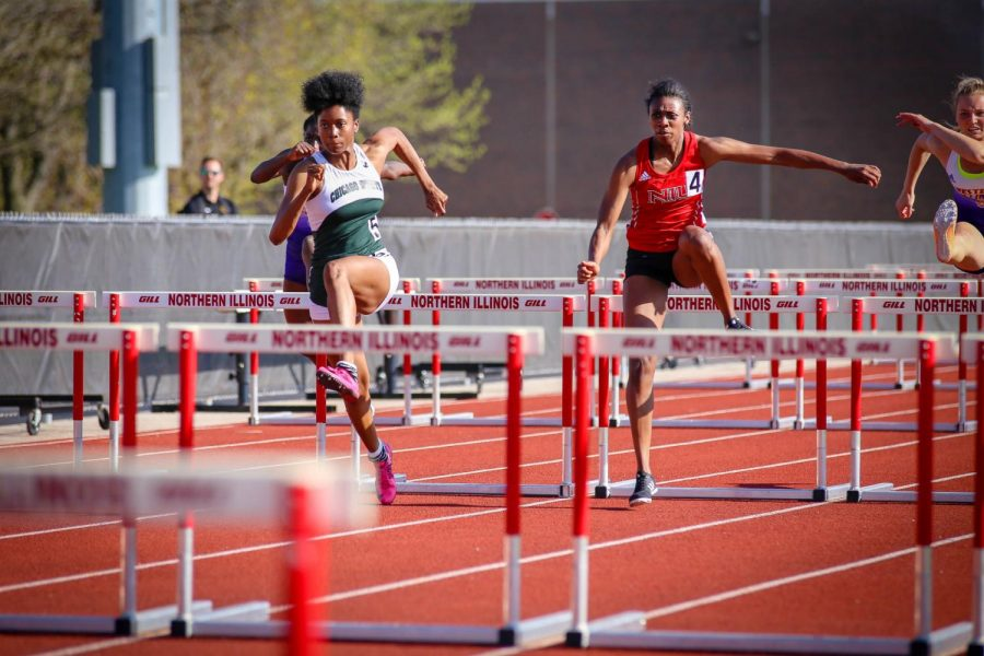 NIU freshman Kishona McCray leaping over a hurdle during the 100-meter Friday afternoon at the Huskie Classic. Isiah Jacobs | Northern Star
