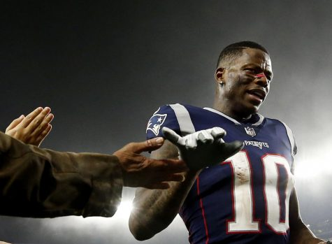 FILE - In this Dec. 2, 2018, file photo, New England Patriots wide receiver Josh Gordon is congratulated after an NFL football game against the Minnesota Vikings at Gillette Stadium, in Foxborough, Mass. Patriots receiver Josh Gordon says he is stepping away from football in order to focus on his mental health. In a statement posted on Twitter on Thursday morning, Dec. 20, 2018, Gordon said his decision was spurred by him feeling recently that he could have a better grasp on things mentally. He thanked the Patriots for their support and vowed to work his way back. (AP Photo/Winslow Townson, File)