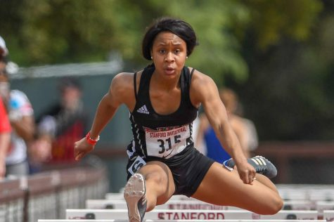 Sophmore jumper Kenyae Majors leaps during the Huskies March 31, Stanford Invitational meet. Majors would go on to place 15th in the 100-meter hurdles for her efforts.